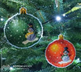 Oranžová a zelená vianočná guľa s motívom snehuliaka
